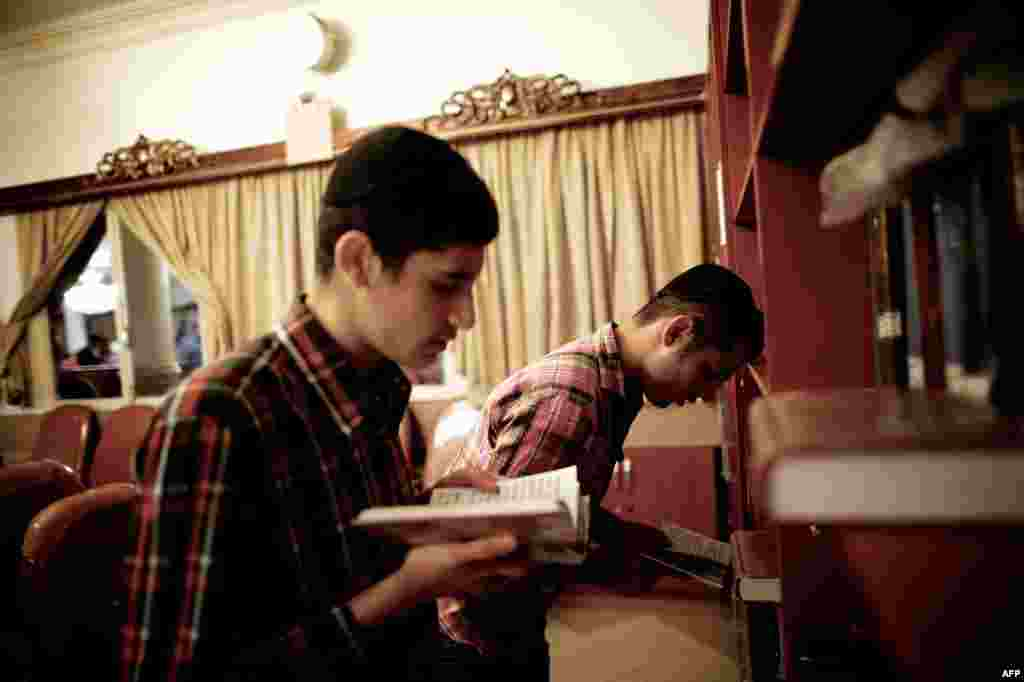 Iranian Jews read the Torah at a Tehran synagogue.