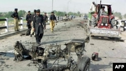 A bomb attack on August 28 targeted a police bus, killing 11 people in Bannu, 250 kilometers southwest of Islamabad.