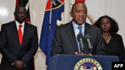 Kenyan President Uhuru Kenyatta speaks during a press conference in Nairobi in front of Kenyan Vice President William Ruto (left) on September 24.
