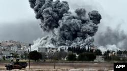 Сирияның Кобани қаласындағы соғыс көрінісі. 12 қазан 2014 жыл.