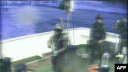 "A television grab of Turkish TV channel Cihan News Agency shows Israeli troops storming the ""Mavi Marmara"" Turkish aid boat, carrying aid to the Gaza Strip, in May 2010."