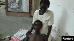 Haiti: Një person që vuan nga kolera.