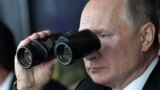 Russian President Vladimir Putin watches a military exercise in 2019.