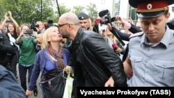 Russian theater director Kirill Serebrennikov (center), who was accused of embezzling state funds and placed under house arrest, is kissed by a supporter after a court hearing in Moscow in September.