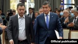 The new prime minister of Kyrgyzstan, Sadyr Japarov (left), and the former president, Sooronbai Jeenbekov, in Bishkek on October 16