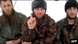 Islamist insurgent leader Doku Umarov (center) recorded his appeal in an undisclosed location.