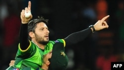 FILE: Shahid Afridi (L) celebrates with his teammate Umar Akmal.
