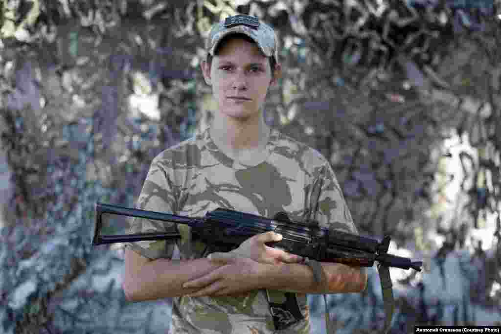 """Oleksandra, a 20-year-old soldier who told Stepanov that """"since childhood, I wanted to join the army."""" The photo was taken near Novotoshkovskoye in September 2018.  The photographer's latest project, titled Independent, focuses on fighters like Oleksandra, whose youth means they have only ever known an independent Ukraine."""
