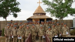 Afghanistan - Armenian soldiers pose for a photograph after being awarded by their German commanders, Kunduz, May, 2010