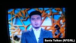 """Ергали Алпысбаев, имам мечети """"Құспан молла"""" в Атырау, выступает по местному телевидению. 24 июля 2013 года."""