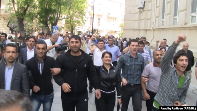 Some 100 opposition activists turned out for the unauthorized demonstration in Baku.