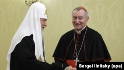 Russian Patriarch Kirill (left) welcomes Vatican Secretary of State Cardinal Pietro Parolin during their meeting in Moscow on August 22.
