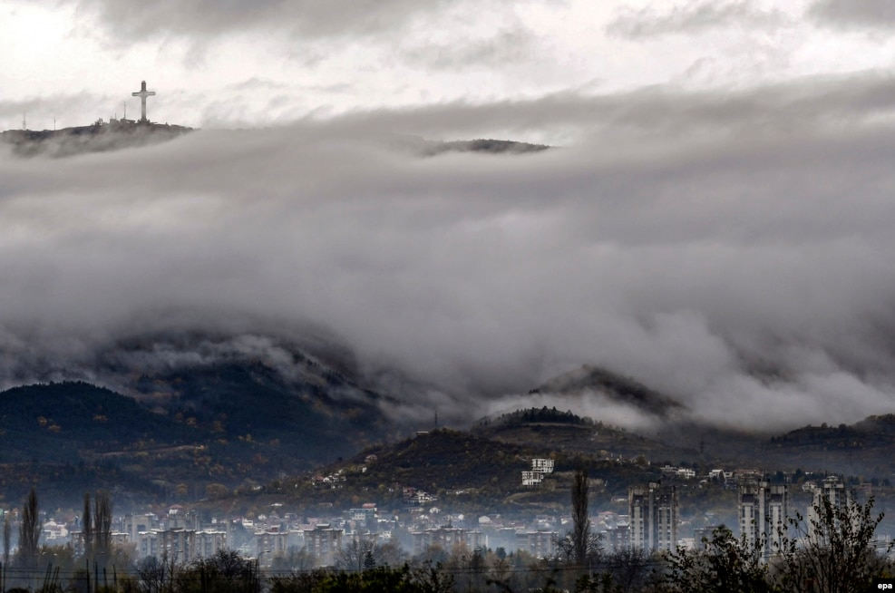 Clouds and fog hang over the Macedonian capital, Skopje, on November 8. (epa/Georgi Licovski)