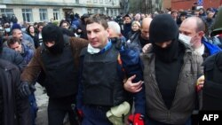 Pro-Russia militants detain the head of the regional police after storming the a police building in the eastern Ukrainian city of Horlivka, near Donetsk.