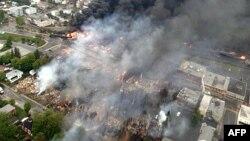Flakë dhe tym nga përplasja e trenit me naftë në Kuebek të Kanadasë