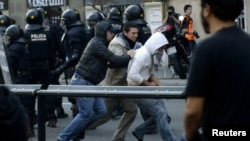 Policemen in plain clothes detain a protester during a general strike in central Barcelona, 29Mar2012