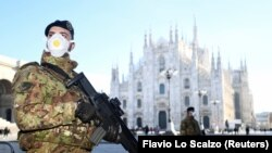 Soldiers wearing face masks stand outside the Duomo cathedral, closed due to the coronavirus outbreak, in Milan, Italy, on February 24.