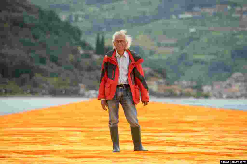 Christo poses on The Floating Piers on Lake Iseo in June 2016.