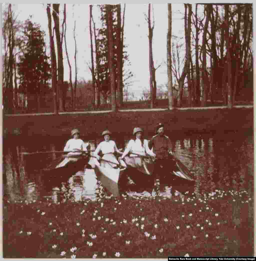 Nicholas II and three of the grand duchesses floating in one of the canals of Tsarskoe Selo, near St. Petersburg.