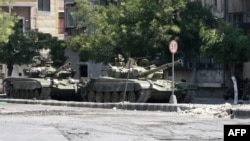 Government tanks in the Midan neighborhood of Damascus on July 20