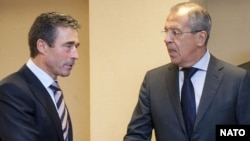 NATO Secretary-General Anders Fogh Rasmussen (left) talks with Russian Foreign Minister Sergei Lavrov about renewed cooperation between Russia and NATO.