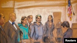 A court sketch of the men accused of aiding Islamic State: Akhror Saidakhmetov (third left), Abdurasul Juraboev (fourth right), and Akhror Saidakmetov (center).