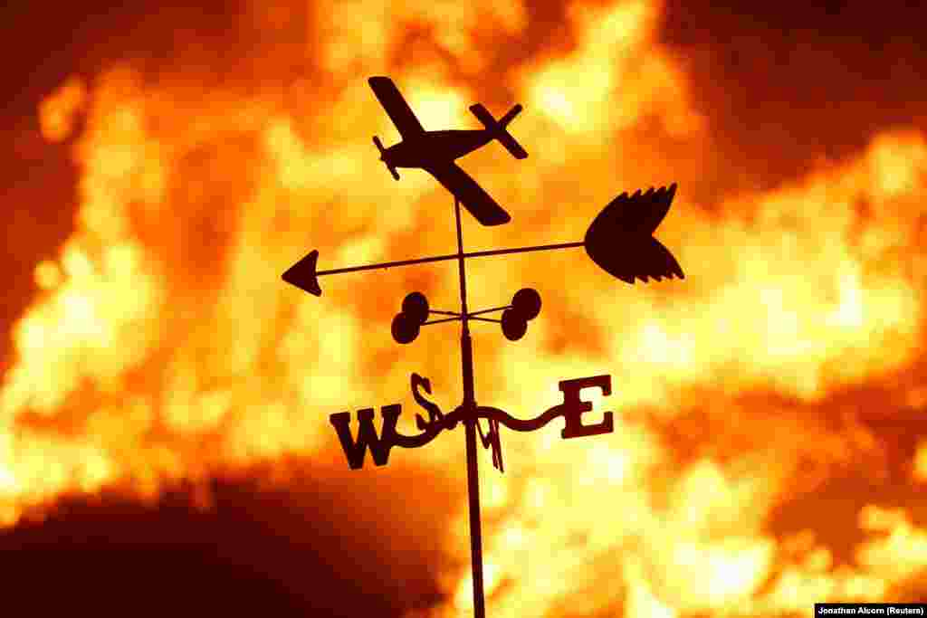 A weather vane is pictured on a ranch during the Creek Fire in the San Fernando Valley north of Los Angeles, California. (Reuters/Jonathan Alcorn)