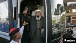 An activist who was seized during the aid-convoy raid bound for Gaza gestures upon his arrival in Jordan on June 2.