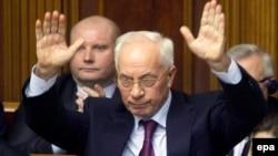 Ukraine -- Prime Minister Mykola Azarov gestures during the parliamentary session in Kyiv, December 3, 2013