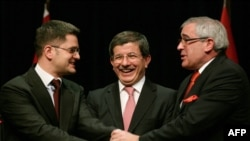 Turkish Foreign Minister Ahmet Davutoglu (center) brought together his Serbian and Bosnian counterparts, Vuk Jeremic (left) and Sven Alkalaj at a meeting in Ankara in February.