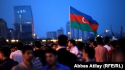Azerbaijan fans celebrate in Baku during the final of the Eurovision Song Contest in May 2012.