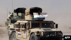 قوات عراقية في طريقها الى آمرلي قبل تحريرها من داعش