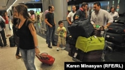 Armenia -- Syrian Armenians arrive in Yerevan, 17Aug2012