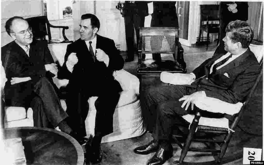 "U.S. President John F. Kennedy (right) meets for two hours with Soviet Foreign Minister Andrei Gromyko (center) and Soviet Ambassador Anatoly Dobrynin in Washington on October 18. The Soviets say aid to Havana is intended to boost the ""defensive capabilities of Cuba."""