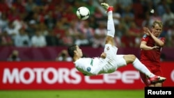Poland -- Portugal's Cristiano Ronaldo kicks the ball during their Euro 2012 quarter-final soccer match at the National stadium in Warsaw, 21Jun2012