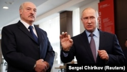 Russian President Vladimir Putin (right) speaks next to Belarusian President Alyaksandr Lukashenka during their meeting in the Black sea resort of Sochi on February 15.