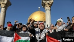 Worshippers chant as they hold Palestinian flags after Friday prayers in Jerusalem's Old City December 8.