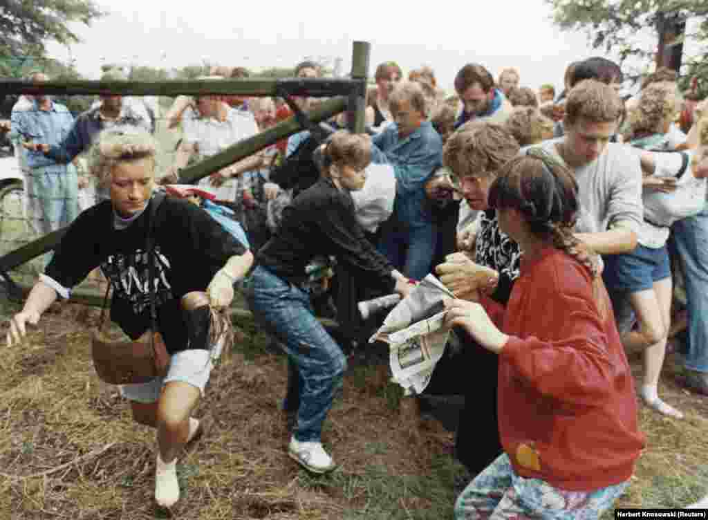 After East German refugees learned about the Pan-European Picnic from posters and fliers, hundreds arrived at the location and stormed through the border fence into Austria.