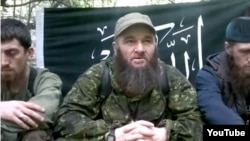 A screen grab of Chechen insurgent Doku Umarov from a video posted on YouTube on December 18, just hours after Chechen Republic head Ramzan Kadyrov told journalists in Moscow that the Islamist rebel was dead.
