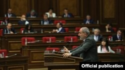 Armenian caretaker Prime Minister Nikol Pashinian speaks in parliament on May 10.