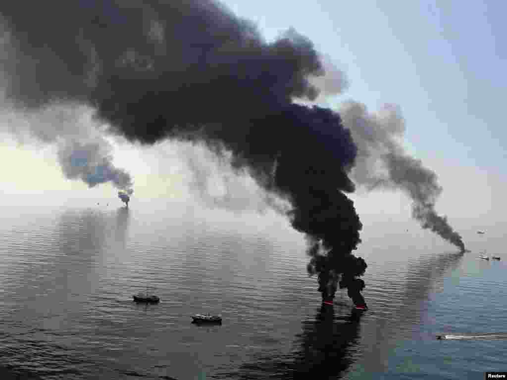 Smoke billows from a controlled oil burn off the Louisiana coast in the Gulf of Mexico, where millions of gallons of oil have poured from a ruptured BP well. Photo by Sean Gardner for Reuters
