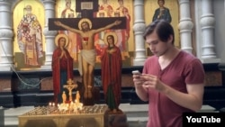 In a case that has drawn fire from international rights watchdogs, Ruslan Sokolovsky faces up to five years in prison for videos he posted on YouTube, including one of him playing Pokemon Go in a Yekaterinberg cathedral. (file photo)