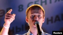 Russia -- Opposition leader Aleksei Navalny addresses supporters during a rally in Moscow, September 9, 2013