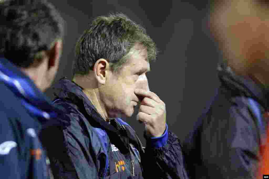 Bosnia's head coach Safet Susic looks on anxiously during a tight game.