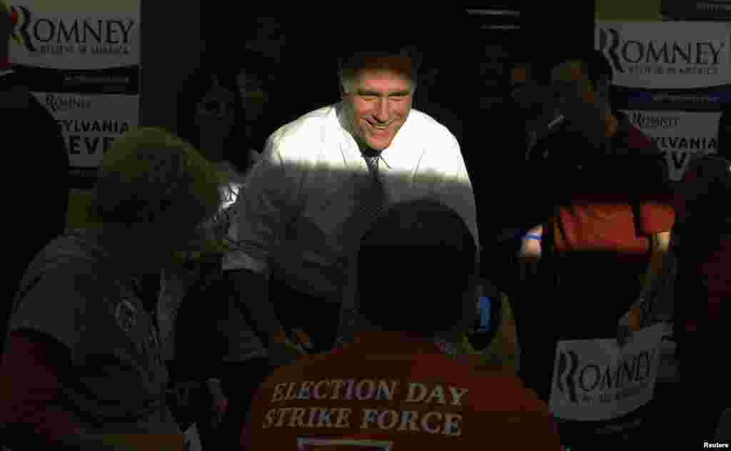 Mitt Romney greets workers at a campaign call center in Green Tree, Pennsylvania.