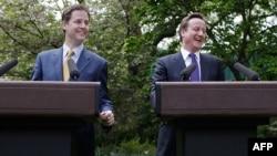 Британский премьер Дэвид Кэмерон и его заместитель Ник Клегг