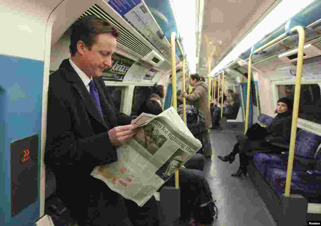 Conservative Party leader David Cameron, who is now prime minister, travels on the Tube after a news conference in 2008.