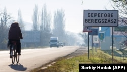 Inscriptions in two languages, Ukrainian and Hungarian, are seen on a road sign of Berehove, a small town in western Ukraine.