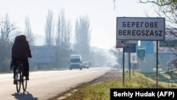 Inscriptions in two languages, Ukrainian and Hungarian, are seen on a road sign in Berehove, a small town in western Ukraine.