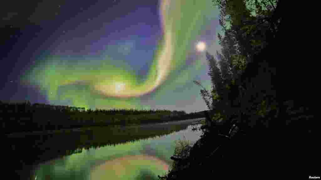Swirls of green and red appear in an aurora over Whitehorse, Yukon, on the night of September 3. (Reuters/Courtesy of David Cartier, Sr./NASA)